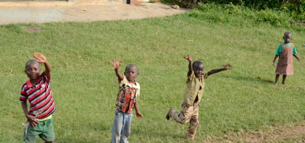 Children waving at our truck