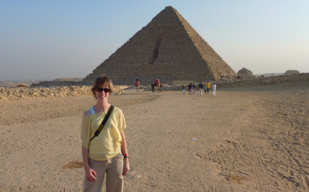 Standing in front of the Pyramids of Giza