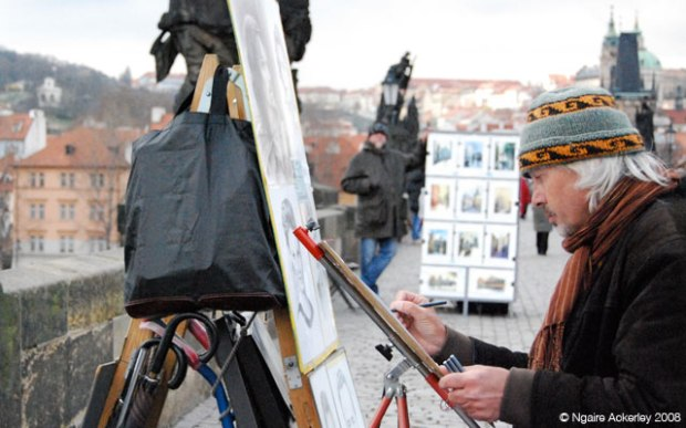 Artist on the Charles Bridge in Prague