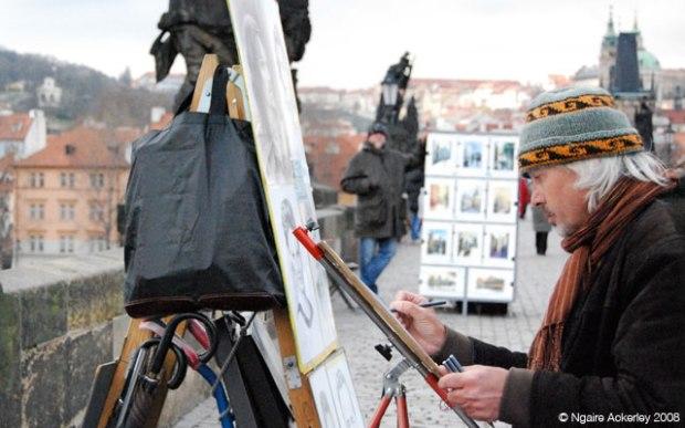 Artist on the Charles Bridge in Prague