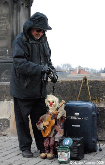 Busker with a musical puppet, Prague, Czech Republic
