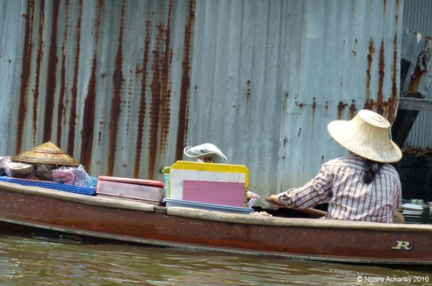 Women travelling by boat in Bangkok