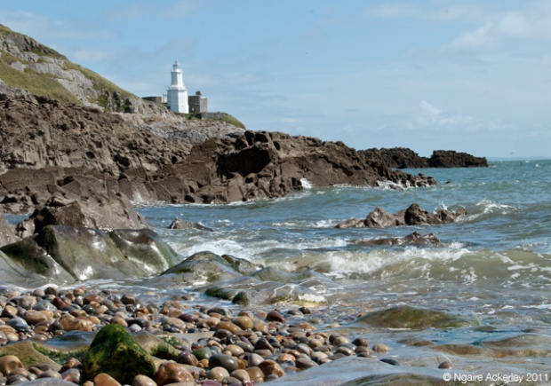 Beach and Lighthouse at beach in the Mumbles, Gower Peninsula, Wales