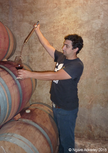 Winery Owner extracting wine