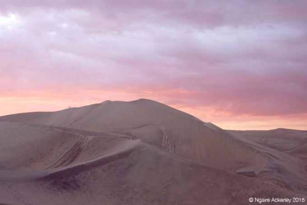 Huacachina sand dunes at sunset