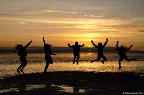 Jumping at sunrise on the Salt Flats, Bolivia