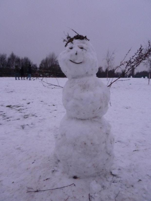 Snowman making in winter