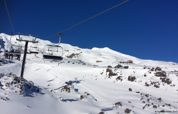 Chairlifts amongst the snowy mountains
